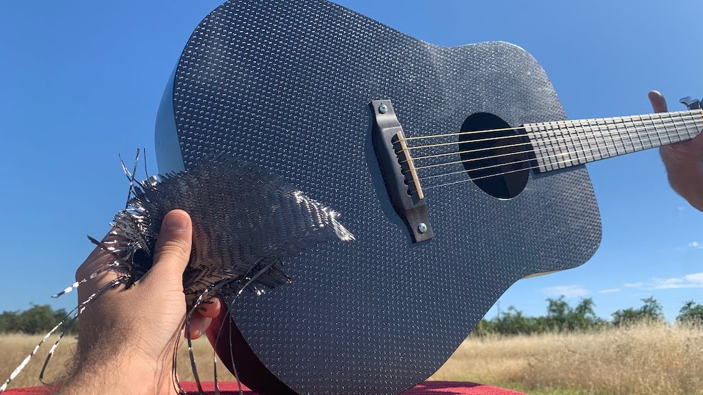 An Acoustic Guitar Made Out Of Carbon Fiber Cloth
