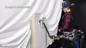 Robotic Third Arm Punching Wall