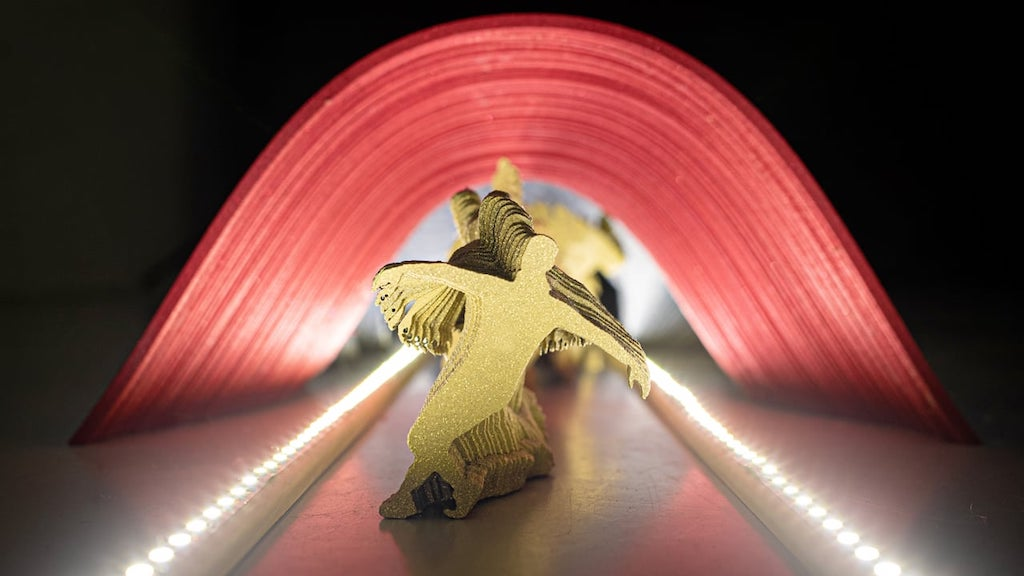 A Dynamic Stop Motion Animation Featuring 800 Laser Cut Figures Dancing Down a Lighted Catwalk