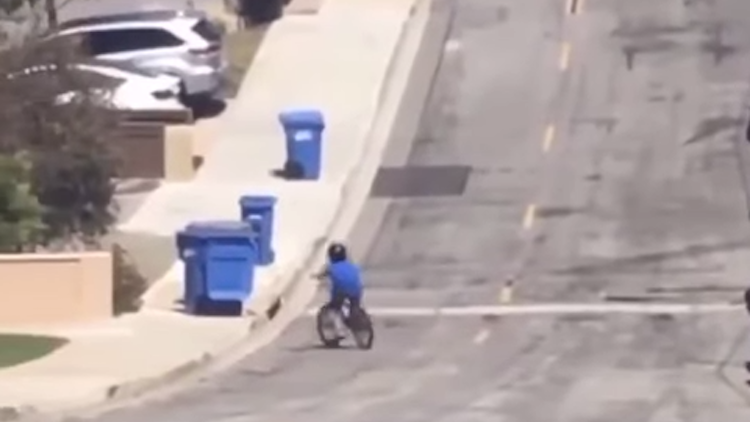 Young Bicyclist Unwittingly Replicates Iconic Drum Solo From 'In the Air Tonight' While Crashing Into Trash Cans