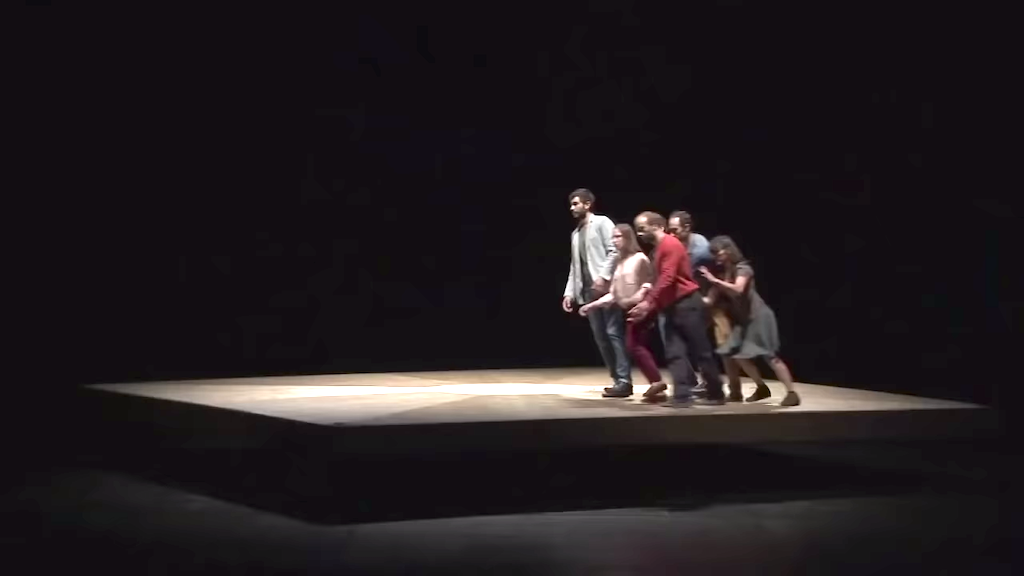 Dancers Attempt to Stand Upright on a Giant Rotating Platform in a Marvelously Choreographed Performance