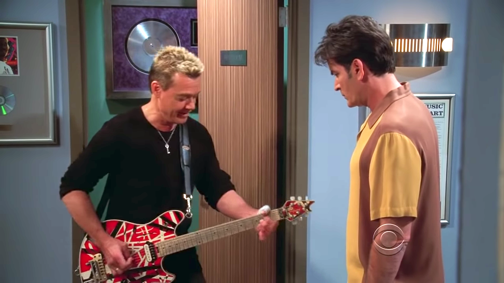 Eddie Van Halen Plays a Guitar Riff Outside the Bathroom in a 2009 Clip From 'Two and a Half Men'