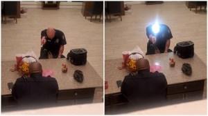 Man Shines Flashlight on Bald Head