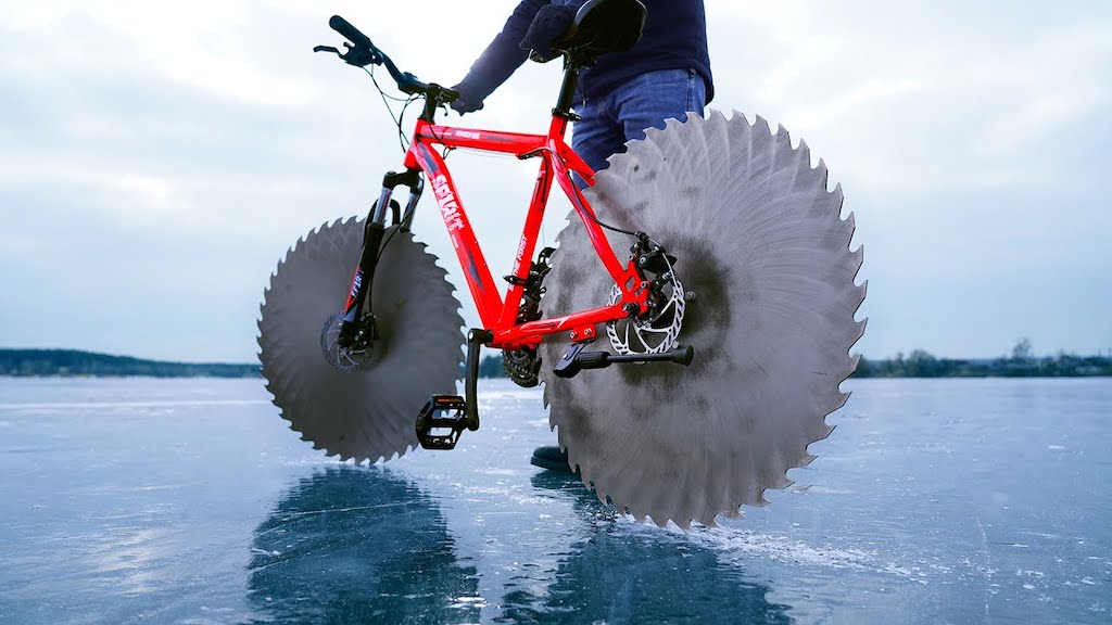 Man Replaces the Wheels on His Bicycle With Giant Circular Saw Blades So He Can Ride Across the Ice