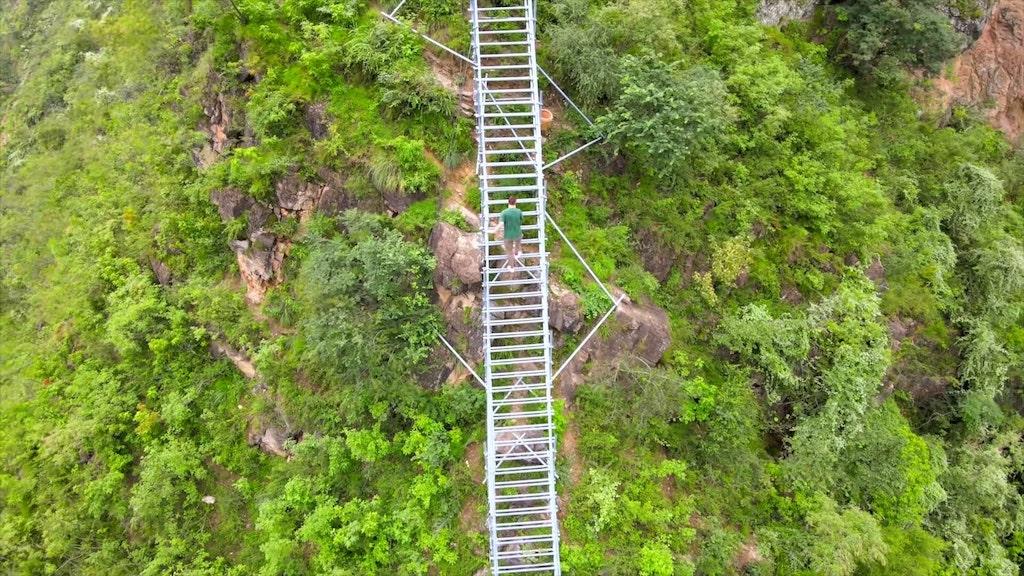 Climbing Steep Mountain Ladder in Sichuan