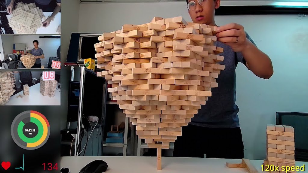Man Stacks an Amazing 1,512 Jenga Blocks Onto One Vertical Jenga Block Breaking His Own World Record