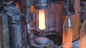 Forging Glass Bottles Along Assembly Line