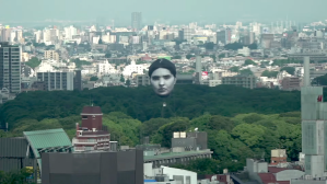 Giant Head Floats Over Tokyo Park
