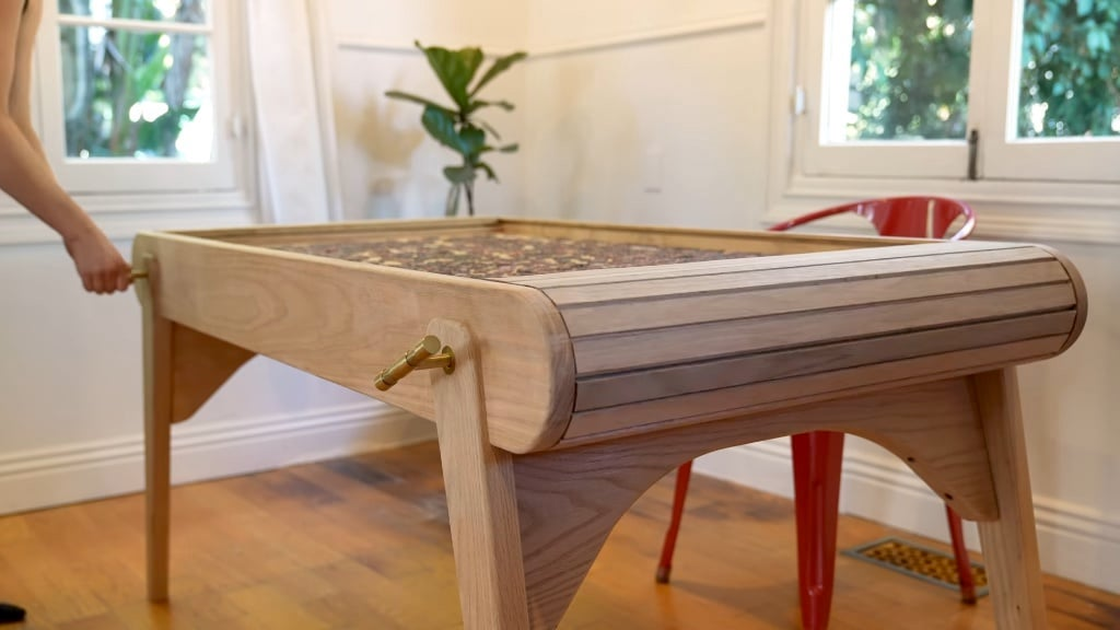 A mechanical table with a hidden table top for puzzles
