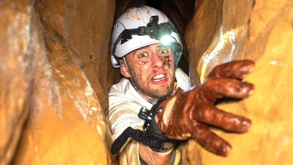 Man With an Intense Fear of Tight Spaces Crawls Through the Most Claustrophobic Cave in the World - laughing squid