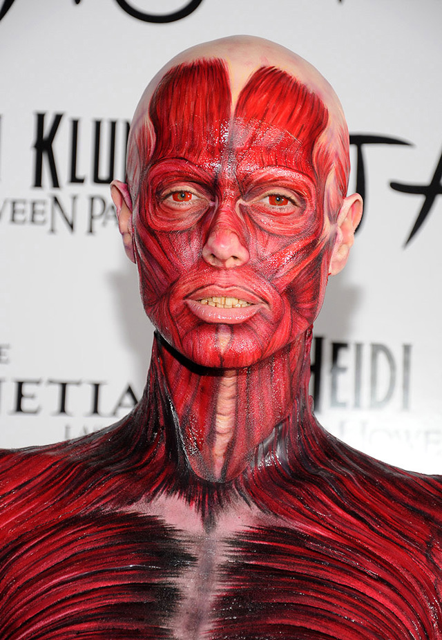 & Heidi Klum Wears a Gory Skinned Dead Body Costume to Her Halloween Party