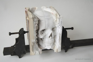 Incarnate, a Human Skull Carved Into Old Software Manuals by Maskull Lasserre