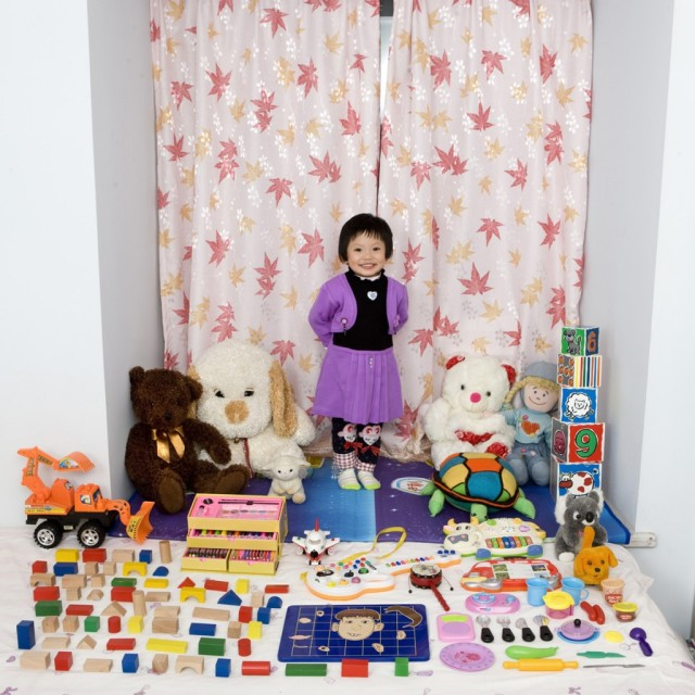 Photos of Kids from Around the World Posing with Their Toys