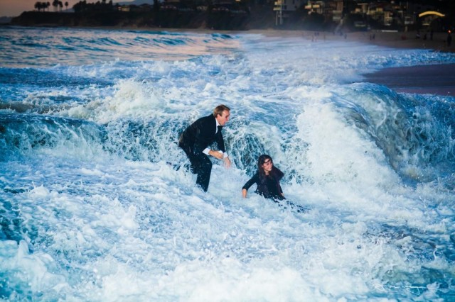 Wedding proposal at beach interrupted by giant wave