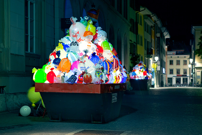 Illuminated plastic garbage by Luzinterruptus