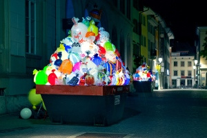 Illuminated plastic garbage by Luzinterruptus
