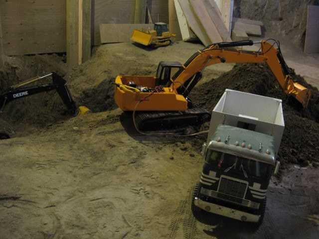 Excavating A Basement With RC Model Construction Equipment