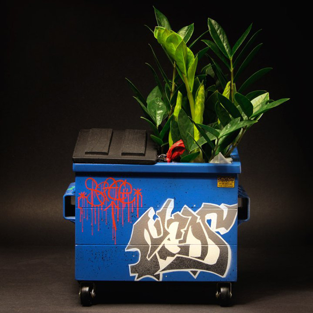 Desktop Dumpster with a plant