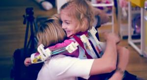 Emma hugging her mom