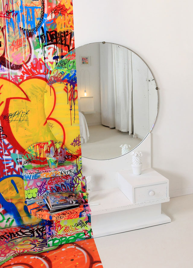 Half graffiti hotel room by Tilt