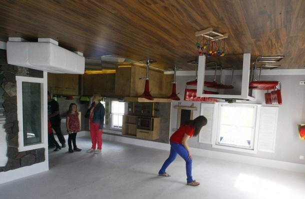 People stand inside room of house