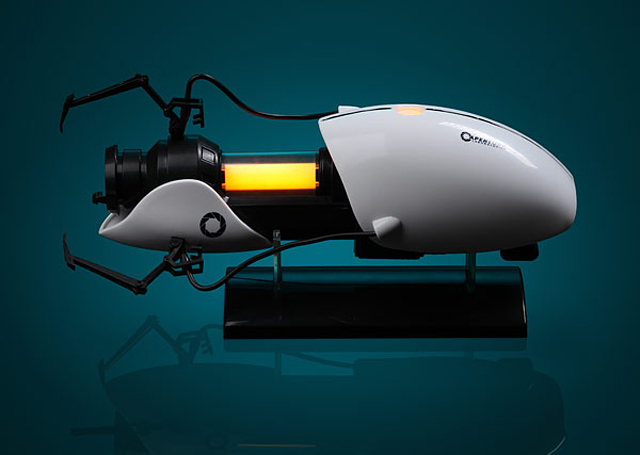 Portal 2 Miniature Replica Portal Gun at ThinkGeek