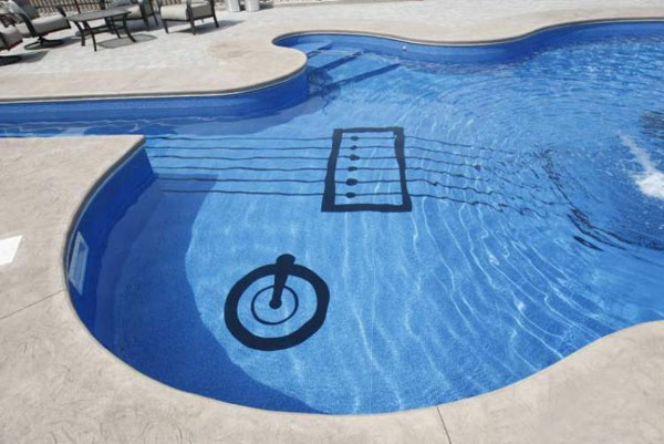 a 62 foot long swimming pool shaped like a les paul custom