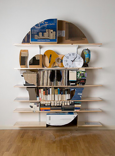 Skull bookshelf sculptures by James Hopkins
