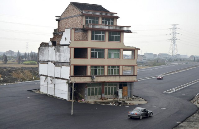 House in the middle of the road