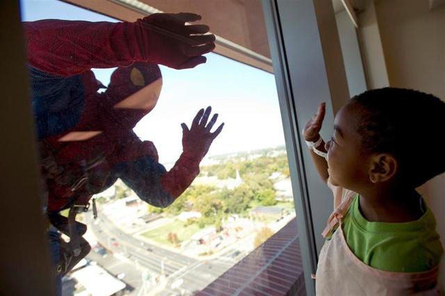 Children's Hospital Window Washers Dress up as Marvel Superheroes