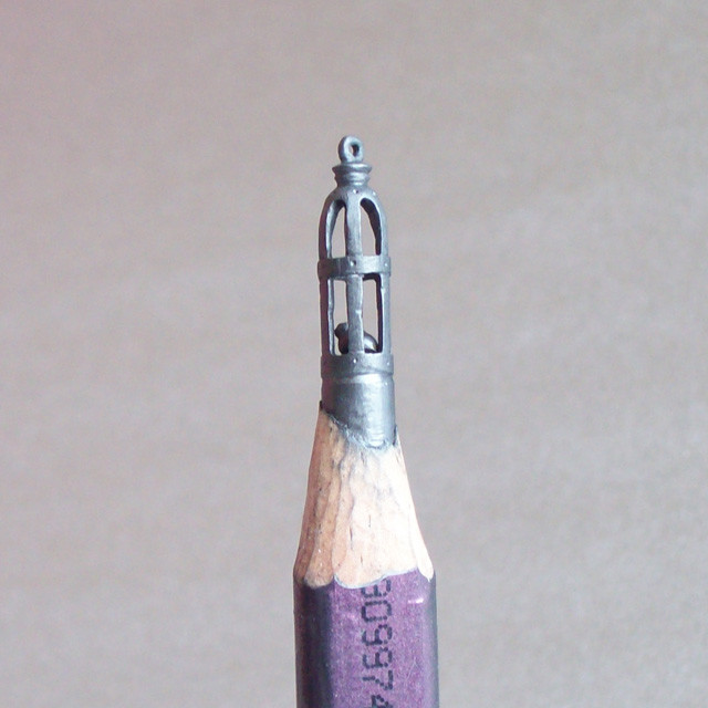 Intricately carved pencil lead sculptures