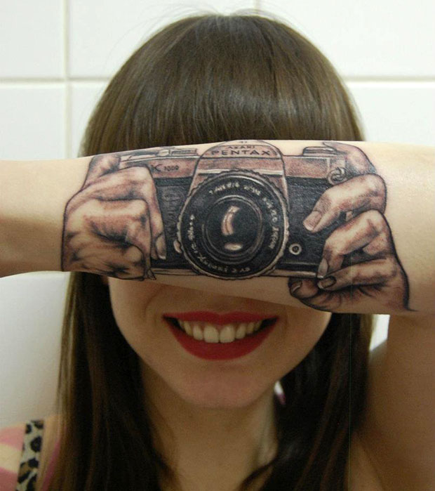 Pentax  camera tattoo by Helma van der Weide