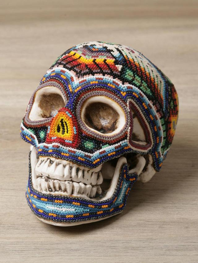 beautiful macabre beaded human skulls by mexican huichol