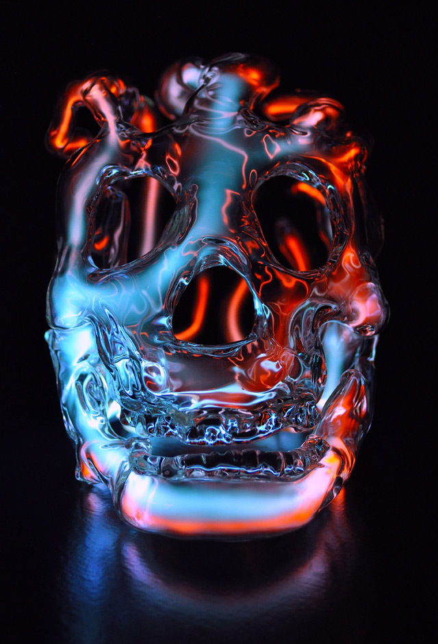 Luminous glass skulls by Eric Franklin