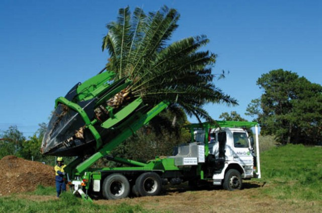 Truck mounted tree spade transplantation